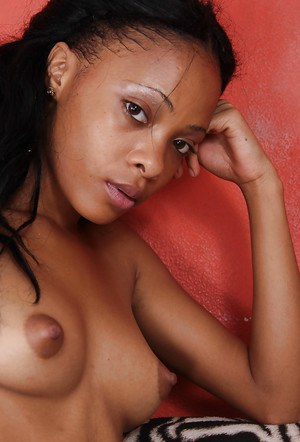 Black amateur Daniella Duarte removes sexy lingerie to show off her naked body
