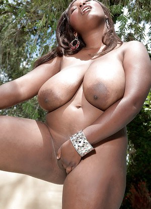 Ebony fatty Marie Leone poses naked in the pool and reveals her fat pussy