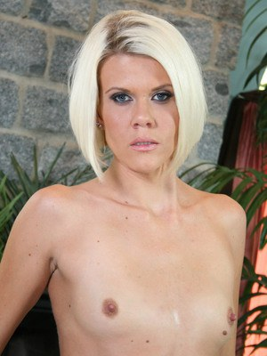 Blonde solo model Jennie McCarthy baring tiny titties and and pink pussy