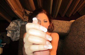 Pretty female Evilyn Fierce licking the nut sac while delivering oral sex