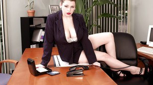 Chubby MILF Desirae exposing hooters on top of her office desk