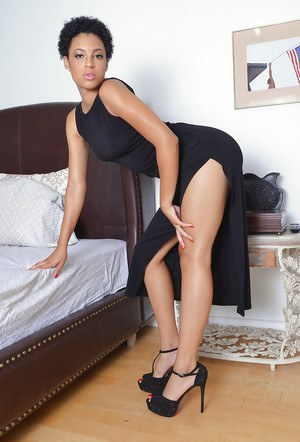 Black amateur Amethyst Banks stretches her pink twat wide open in heels on bed