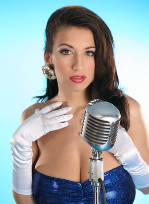 Pinup model Jana Defi flaunting her nice melons in long white gloves