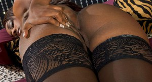 Black solo model Leah Ray flaunts sexy ass while masturbating in stockings
