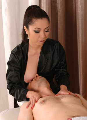 Older Asian masseuse Midori Tanaka delivering a happy ending massage