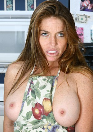 Older woman Casey slips off apron from big tits and natural pussy