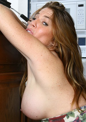 Mature lady Casey gets horny and naked while cooking in kitchen