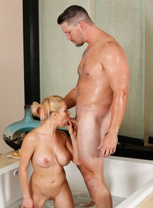 Busty MILF Rachel Roxxx gives a soapy massage and sucks on dick in bathtub