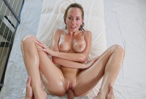 Busty chick Brett Rossi fucks and sucks dick covered from head to toe in oil