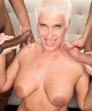 Mature stunner Trinity Powers gets pleasured by a white and a black cock