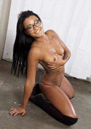 Black solo girl Harley Dean wears glasses while taking off sexy lingeire
