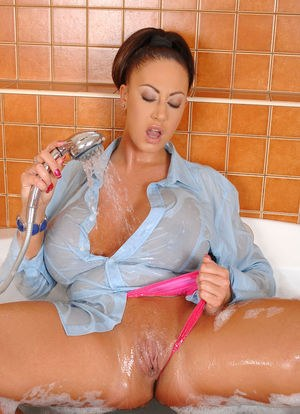 Stunning bursty cougar Emma Butt takes a hot bath and plays with tits and twat