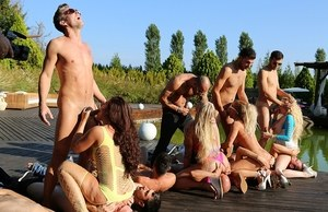 A group of dirty-minded sluts get fucked outdoors by a group of horny guys