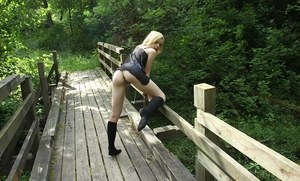 Amateur teen Sophia Kitten showing off naked pussy on bridge in forest