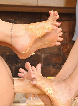 Hot lesbians Eve Angel & Sophie Moone cover barefeet in food stuffs in kitchen