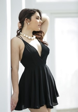 Beautiful brunette Valentina Nappi slips off little black dress to pose naked