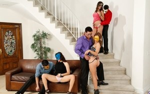 Masquerade party for swingers leads to group sex fucking on stairs and chairs