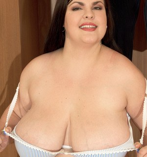 Obese solo model Jelena Jasper loosing monster tits from shirt and brassiere