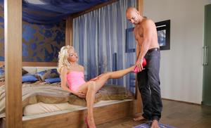 Sexy blonde with great legs getting undressed by her lover before screwing