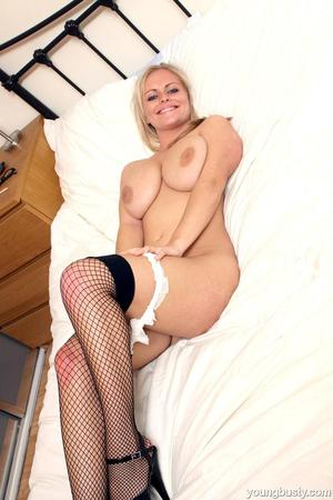 Teen fatty in fishnet stockings strips and shows off her appetising curves