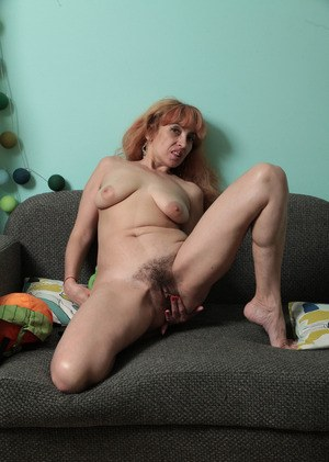Karolina shows off her hairy mature pussy during a really hot solo romance