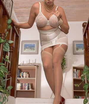 MILF Gianna Rossi models solo in undergarments and pantyhose