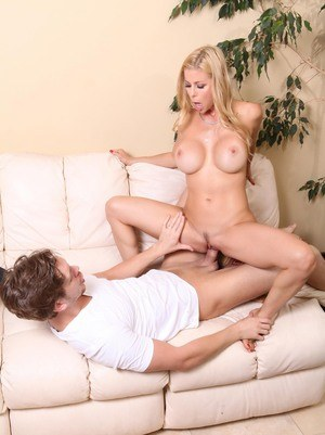 Middle-aged blond Alexis Fawx gets it on kitchen before moving to sofa to fuck