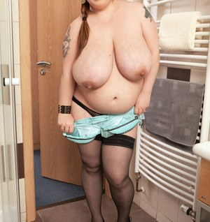 Pregnant BBW Roxanne Miller wets and soaps swollen boobs in shower