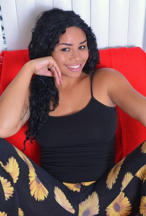 Black first timer Millie Stone smiling while showing her pink pussy