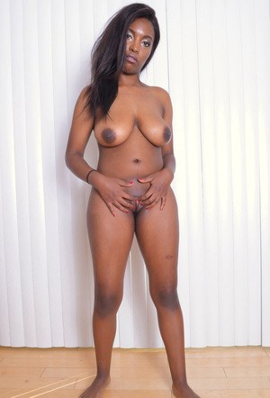 Ebony amateur Daya Knight slips fingers inside labia lips to reveal pink twat