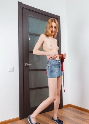 Skinny MILF Kler slips out off denim skirt and thong to show off hairy pussy