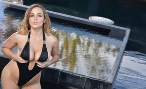 Curvy Euro model Natasha Nice removes her one piece swimsuit in water fountain