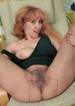 Older woman Karolina needs to remove pantyhose to play with her beaver