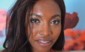 Black amateur Daya Knight opens up her pink slit ta after slipping off panties