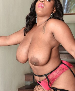 Yummy ebony babe with big bouncing tits shows off her awesome curvy body