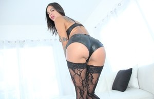 Mouth watering pornstar Bonnie Rotten poses in sexy black stockings and heels