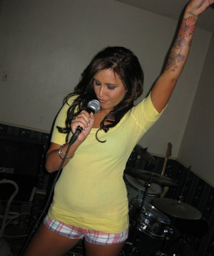 Brunette girlfriend with tiny tits Tasia Banx gets naked after singing karaoke