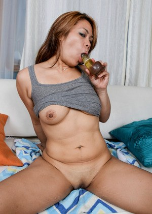 Asian babe Laci Hurst drills her insatiable twat with a big dildo dong