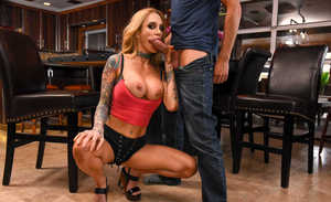 Tattooed MILF Sarah Jessie seduces a married man with her big tits
