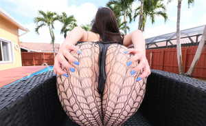 Chubby solo girl Evie Olson slides sexy hosiery over her big butt beside pool