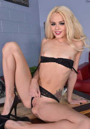 Cute blonde Elsa Jean slides shorts and panties over nice ass while undressing