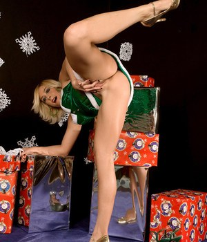 Blonde cutie wears a Christmas costume and green socks playing foot fetish