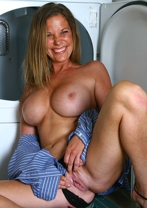 MILF with long legs Veronica takes off black panties and masturbates in a bath