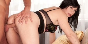 Brunette cougar Lilly and her young lover fuck like a couple of rabbits