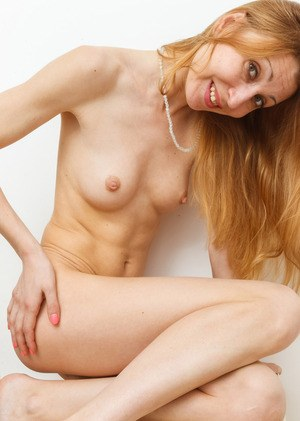 Older redhead woman Kler removes pantsuit show off her hairy vag in the buff
