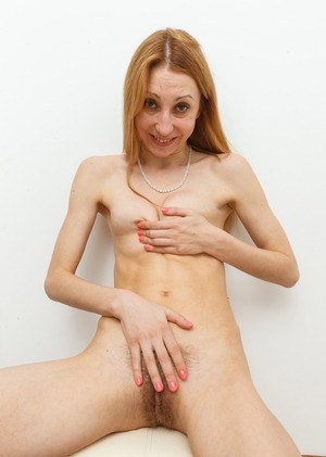 Experienced redhead Kler bares her tiny tits before parting of hairy pussy