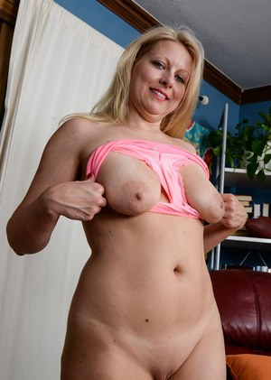 Mature woman Zoey Tyler stretches her bald pussy wide open after panty removal