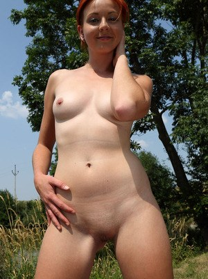Amateur Veronica Red has her shaved pussy pegged by her gf in grassy field