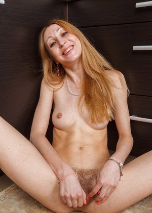 Skinny middle-aged redhead Kler playful strips to show off her hairy muff