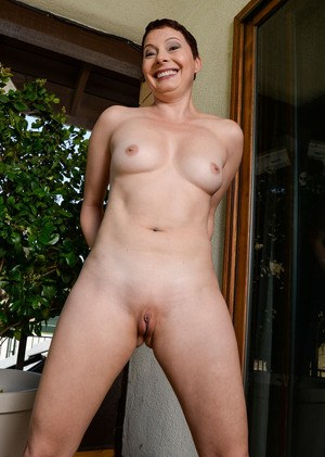 Mature lady with short hair Kali Karinena strips and shows her wide open pussy